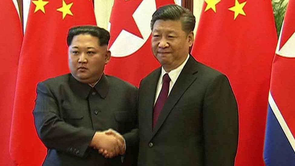 ¿Xi protege o alerta a Kim? Foto: Captura